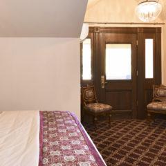 Bed, door, and fireplace